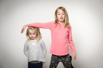 Little girls pulling funny faces - going cross-eyed