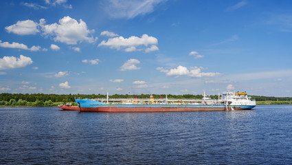 Cargo ship near the shore of river