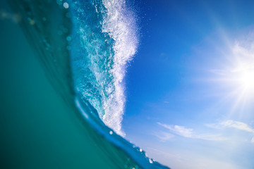 Big ocean surfing wave split view from water surface