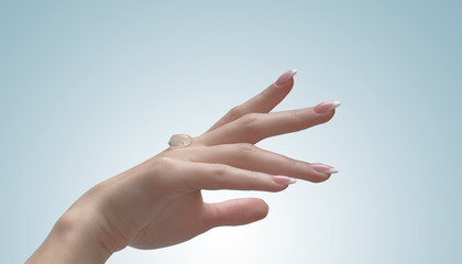 A transparent gel to apply on a female hand