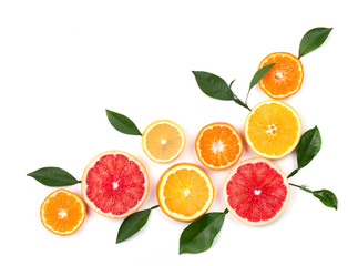 Citrus fruits isolated on white background. Isolated citrus fruits. Pieces of lemon, pink grapefruit and orange isolated on white background, with clipping path. Top view