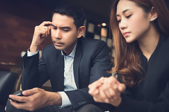 Young Asian couple getting stressed and disappointed