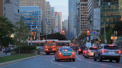 Wall Mural - Busy street in the city of Toronto at dusk. Province of Ontario, Canada
