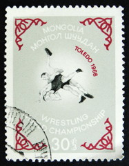 MOSCOW, RUSSIA - APRIL 2, 2017: A post stamp printed in Vietnam shows Two wrestlers, Wrestling World championship in Toledo, 1968, circa 1968