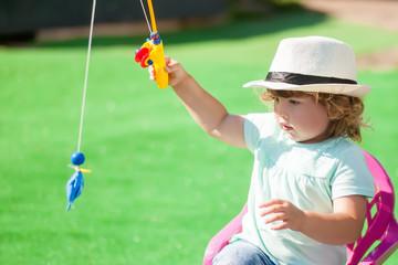 Adorable little girl fishing.