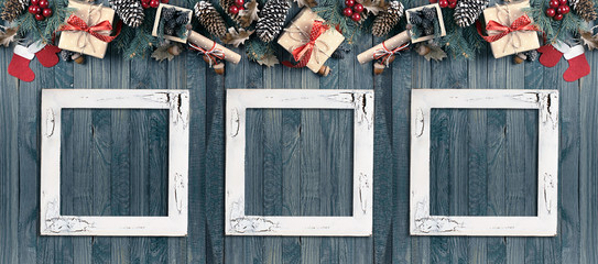 Christmas banner with photo frames, spruce, gift box, Santa Claus boots and scroll in vintage style on wooden boards background