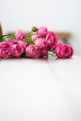 Photo of pink flowers on table