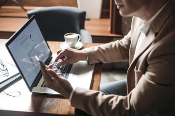 Businessman Typing on Laptop