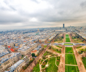 Fototapete - Paris aerial skyline with Champs de Mars on a cloudy winter day,
