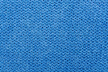 Blue woolen knitting fabric texture background