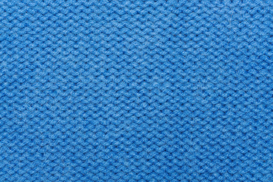 Blue woolen knitting fabric texture background