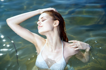 2043237 Beautiful young woman is resting on the sea, ocean, summer, sun, beach