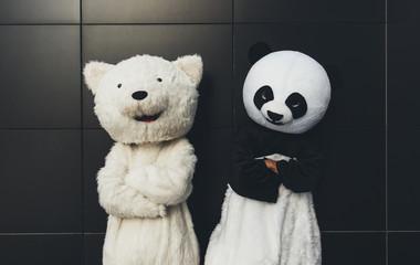 Panda and teddy bear having fun around the city Wall mural