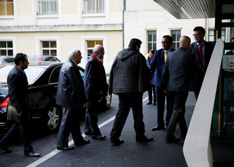 Members of the SNC arrive for a meeting during the  Intra Syria talks at the UN in Geneva