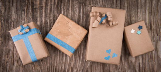 Peper boxes tied with ribbon on wooden background