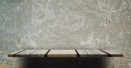Empty wooden counter shelf on grungy cement background for product display