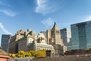 Old and modern skyline of New York City on a sunny autumn day