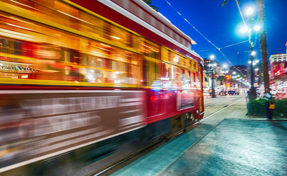 NEW ORLEANS - FEBRUARY 11, 2016: New Orleans streetcar at night, blurred view. The city attracts 15 million tourists every year