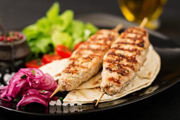 Minced Lula kebab grilled turkey (chicken) with fresh vegetables.