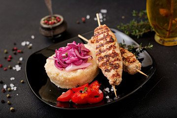 Minced Lula kebab grilled turkey (chicken) with fresh tomato and bulgur