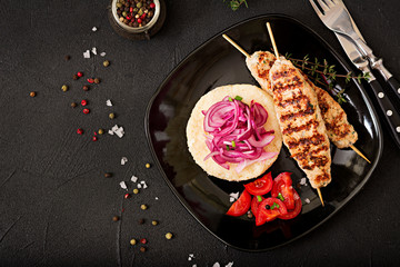 Minced Lula kebab grilled turkey (chicken) with fresh tomato and bulgur. Flat lay. Top iew