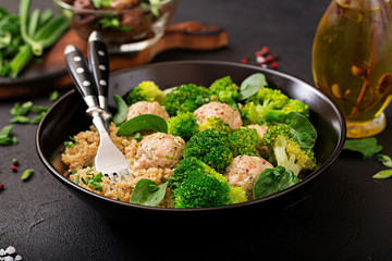 Baked meatballs of chicken fillet with garnish with quinoa and boiled broccoli. Proper nutrition. Sports nutrition. Dietary menu