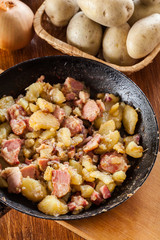 Fried potatoes with onion and bacon