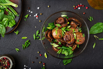 Baked mushrooms with soy sauce and herbs. Top view