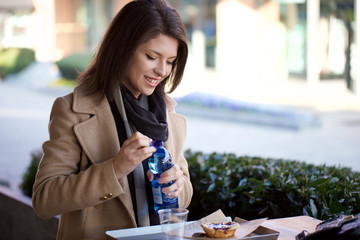 young beautiful woman having break at cafe