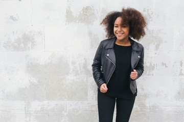 Smiling woman in leather jacket
