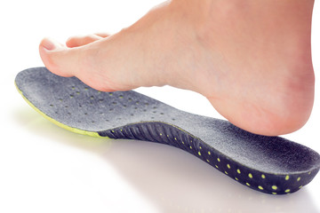 orthopedic insole and female leg