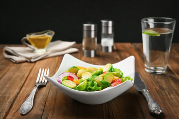 Plate of salad with Brussels sprouts on table