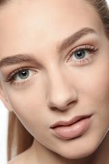 Beautiful woman with long eyelashes, closeup
