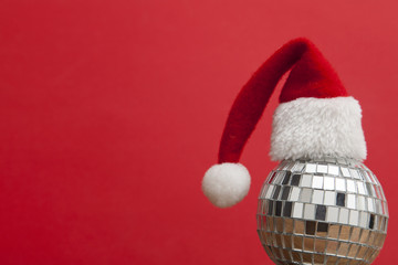 Christmas party background. Santa hat with disco mirrorball
