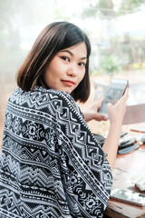 Business asian women cozy dress use cellphone in cafe