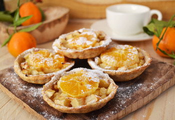 Homemade fruit tarts with caramelized apple and tangerine.