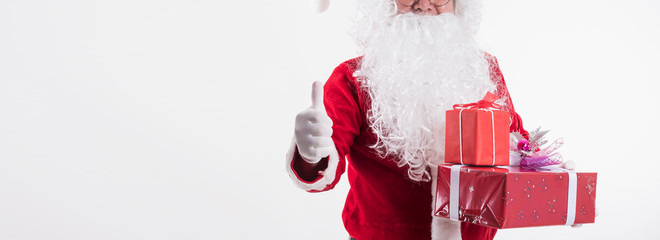Panoramic image of Santa Claus show thumb up and giving gift box on white background with copy space,Christmas decoration holiday party. Merry Christmas and happy new year concept