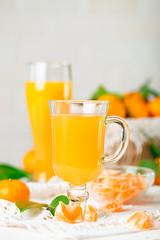 Fresh tangerines and tangerine juice. Healthy food, Selective focus.