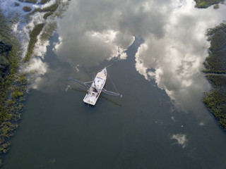 Aerial view of shrimp boat in South Carolina with perfect reflection
