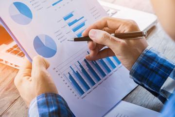 Businessman analyzing financial performance.