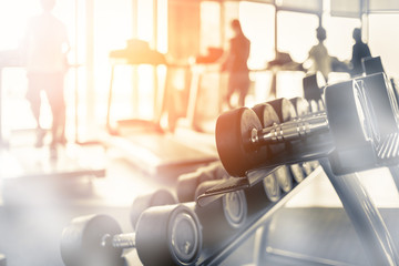 Lifestyle with photo of rows of dumbbells in the gym with hign contrast and monochrome color tone