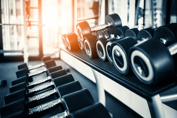 Keuken foto achterwand Fitness Lifestyle with photo of rows of dumbbells in the gym with high contrast and monochrome color tone