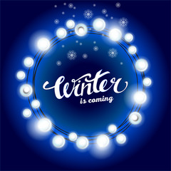Realistic Glittering round string of Christmas`s garland made of incandescent lamps vector white light on dark blue background lettering winter is coming