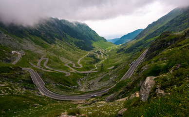 Transfagarasan road in Southern Carpathians on a stormy summer day. beautiful landscape with gloomy sky in Fagaras Mountains of Romania