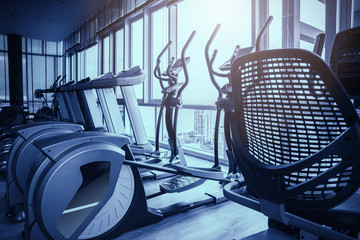 Elliptical in Fitness hall with the sport bikes in it health concept