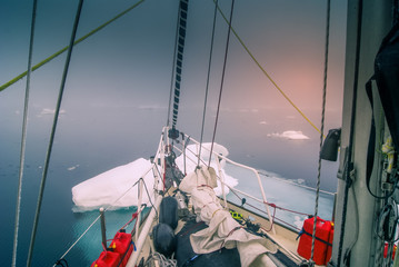 Greenland, sailing boat trough the iceberg, risk, danger in the north pole