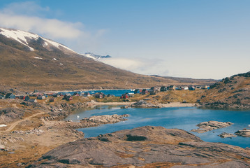 Greenland : bay with an inuit village, colored houses bay with an inuit village