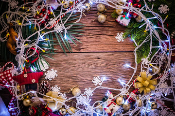 christmas and newyear concept with arrange of decorating items on wooden top with free copy space for your creativity ideas text selective focused at wooden background