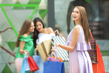 Young woman with shopping bags on city street