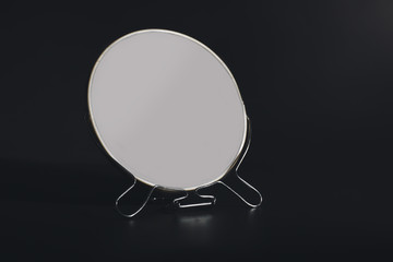 Small mirror on black background